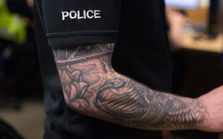 police officer with tattoos