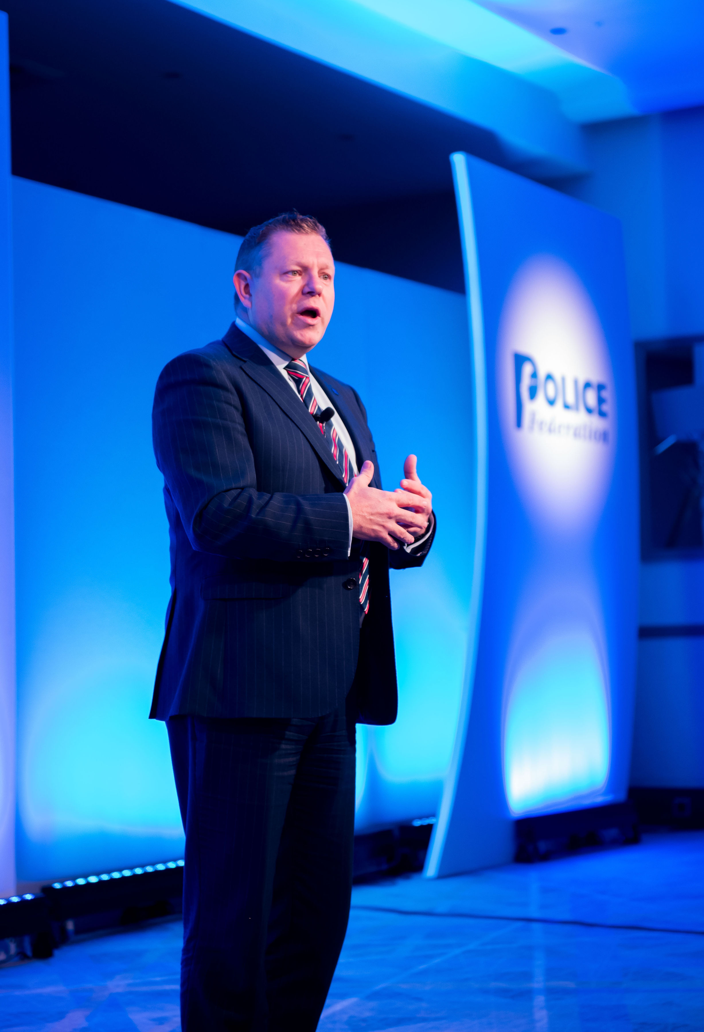 John Apter, PFEW's National Chair addresses the room